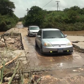 Alley Bridge Damaged by Tropical Storm Grace's Heavy Rains